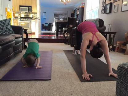 Amanda Randall Henley and her son do yoga.